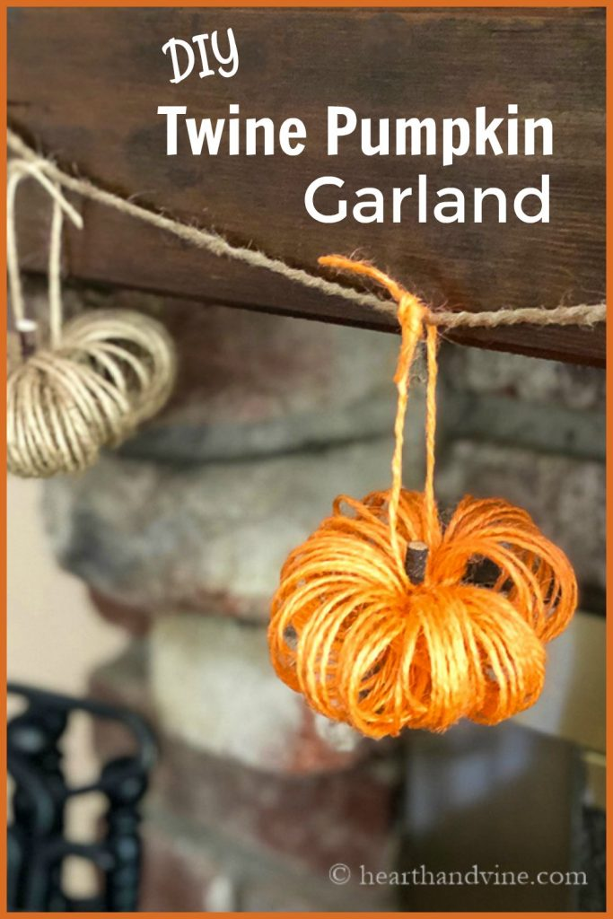 Orange and tan twine pumpkins on garland hanging on mantel.