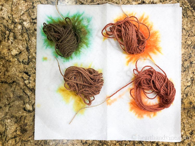 Dyed twine in shades of green, red, orange and brown.
