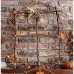 Branch and vine window wreath on mantel with twine pumpkin garland.