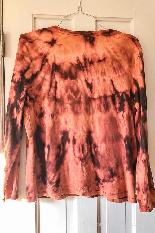Long sleeve black t-shirt after bleach solution.