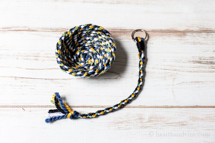 Yarn bowl and keychain made from cardboard loom wheel weaving.