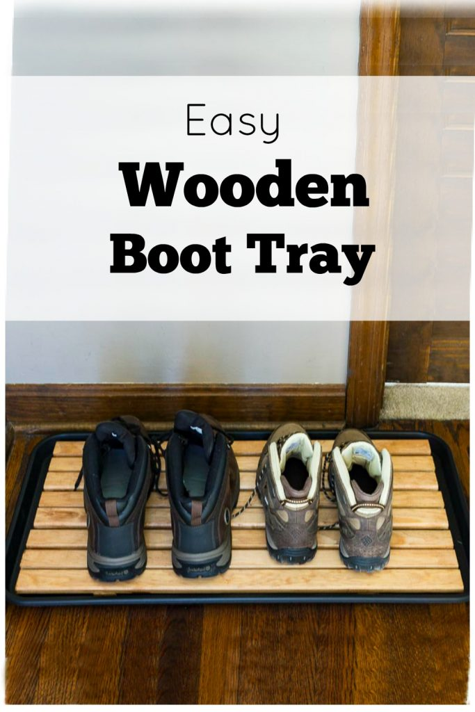Wooden boot tray with two sets of boots on top and text overlay saying easy wooden boot tray.