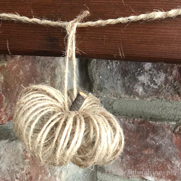 Natural jute pumpkin hanging.