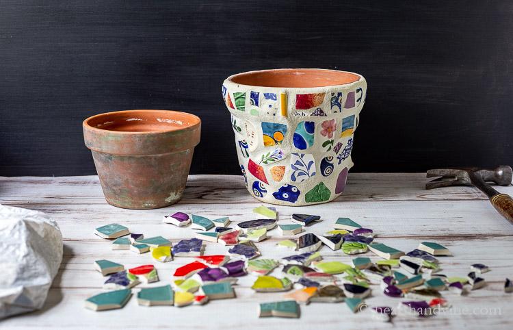 Old terra cotta pot, mosaic pot and broken pieces of ceramics.