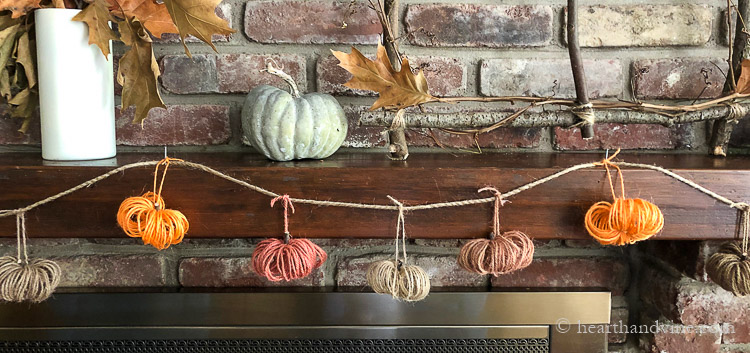 Fall mantel with multi-colored twine pumpkin garland.