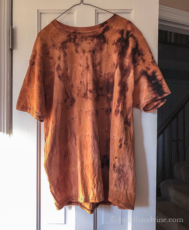 Short sleeve mens black t-shirt after reverse tie dye effect.