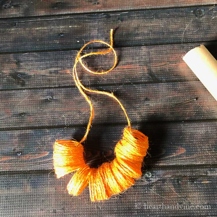 Orange twine removed from cardboard tube.