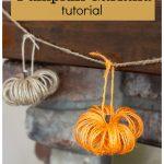 Orange and natural twine pumpkin garland on mantel.