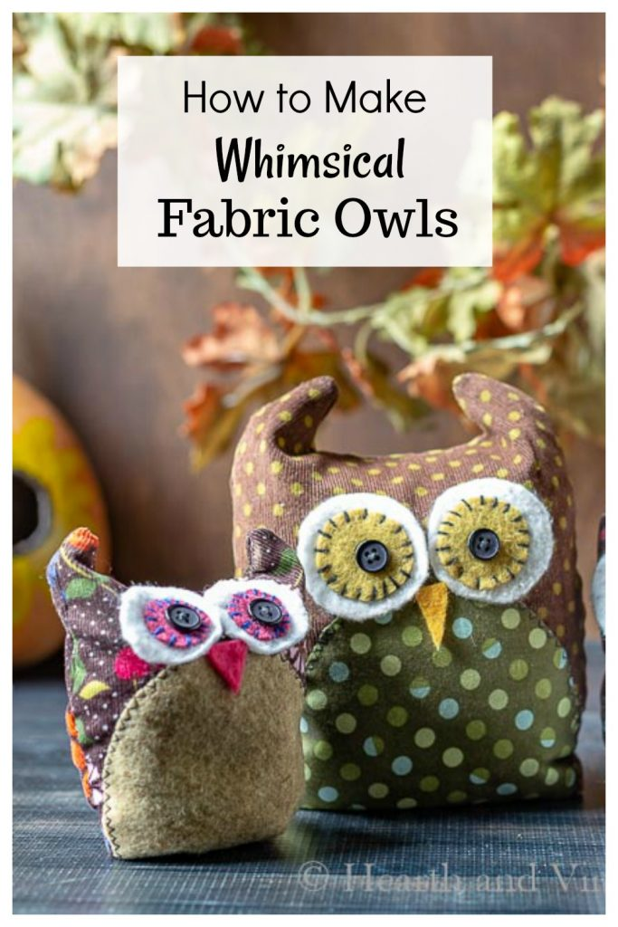 Two fabric owls sitting on a table.
