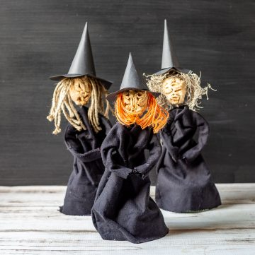 Three apple head doll witches