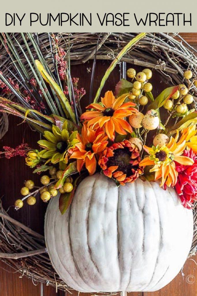 Close up of a floral pumpkin wreath on a door.