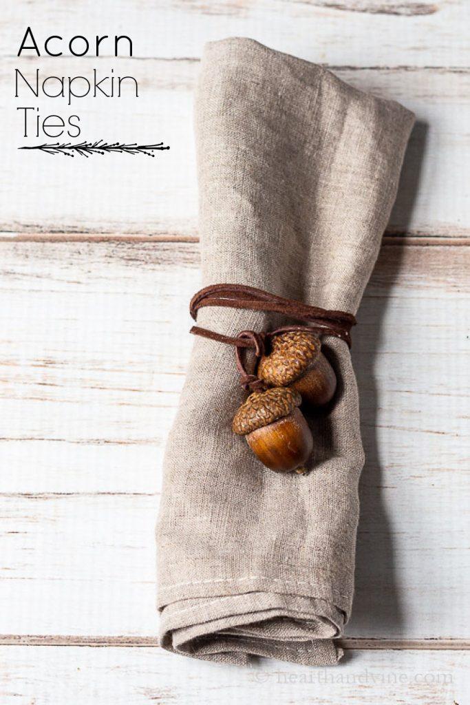 Acorn napkin tie in brown cording wrapped around a linen napkin.