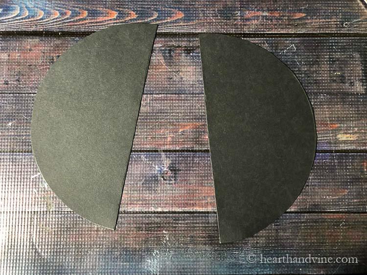 Black card stock circle cut in half.