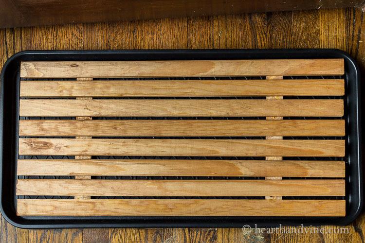 Wooden slat boot tray.