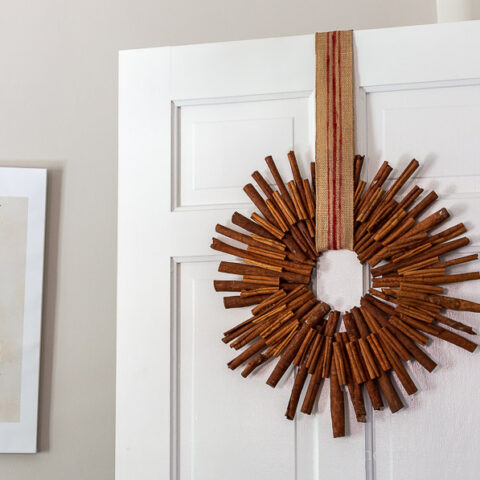 cinnamon stick wreath on white door