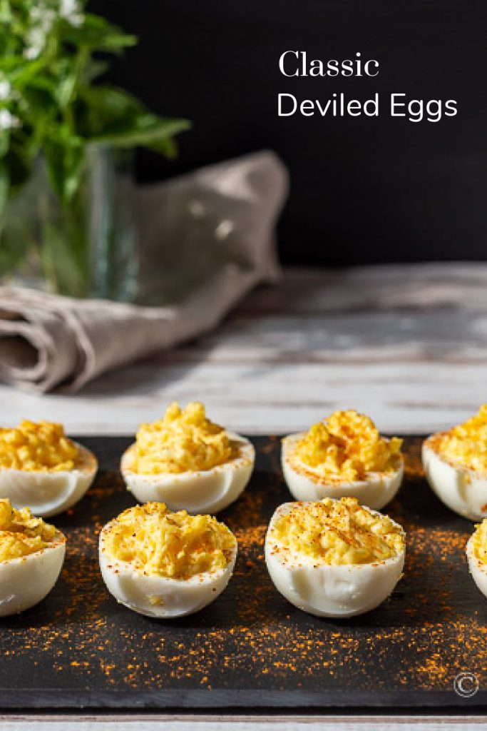 Slate tray with deviled eggs.