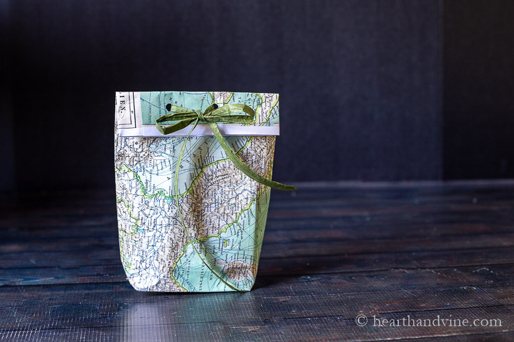 A small paper gift bag made from a map.