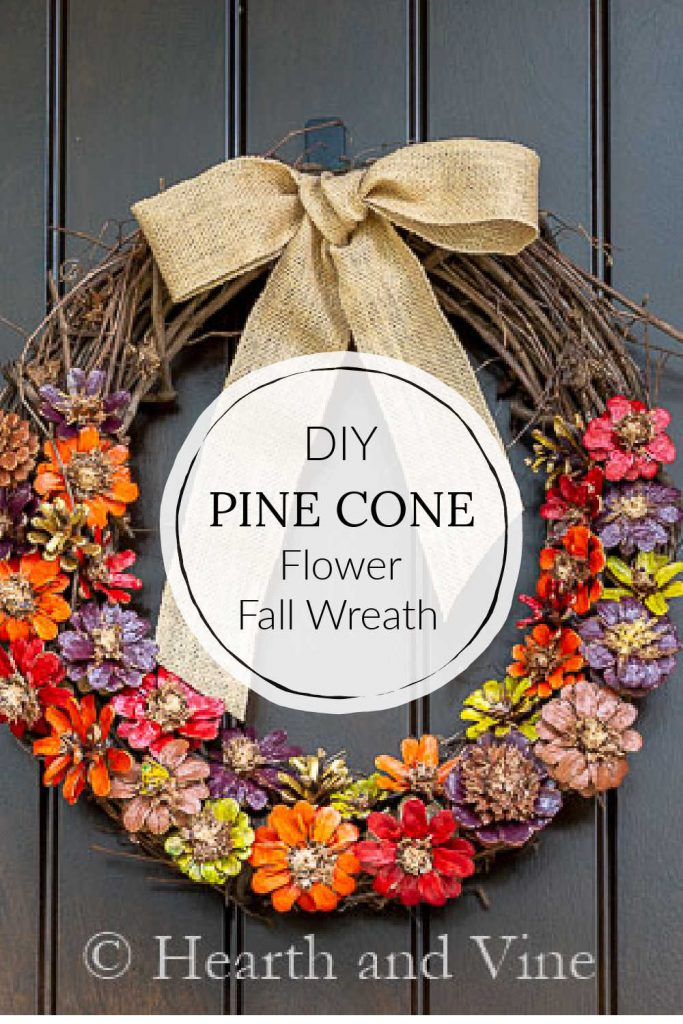 Flower pine cones painted in fall colors and glued to a grapevine wreath with a burlap bow.