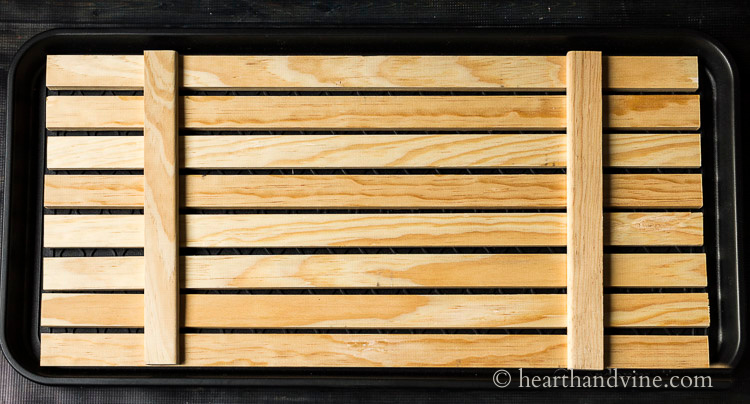 Back of wooden slat boot tray.