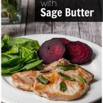 Plate of skillet pork chops, spinach and sliced red beets.
