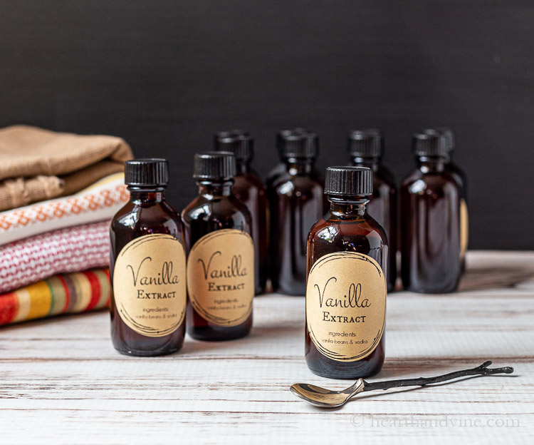 Several vanilla extract bottles and a small spoon.