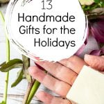 Hand with lotion bar above flowers and a text overlay about 13 handmade gifts for the holidays.