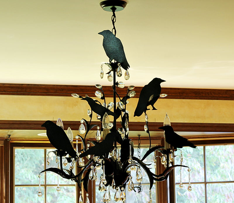Scary bird silhouettes on a dining room chandelier.