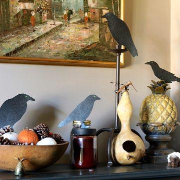 Black paper birds on hallway dresser.