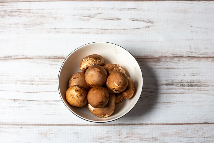 Bowl of baby bella mushrooms.