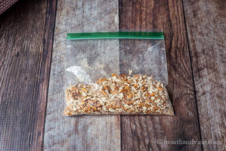 Plastic bag of crushed pretzels.