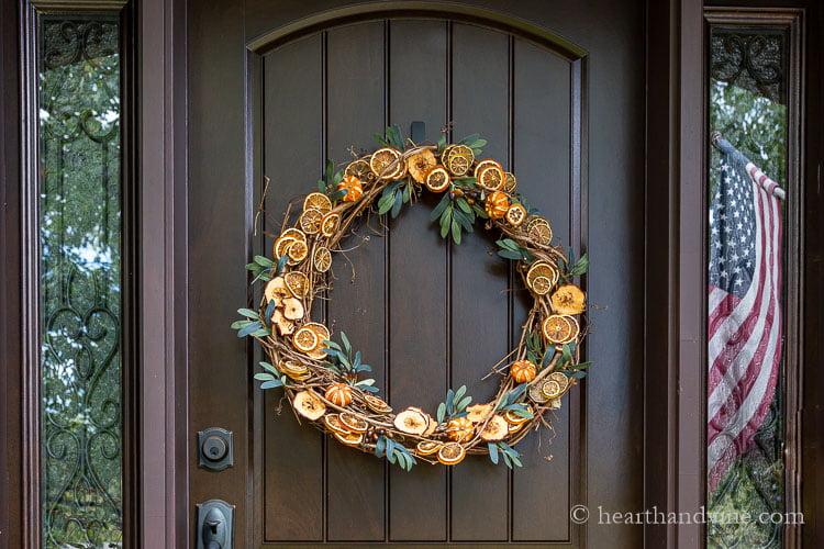 Dried fruit wreath on front door.