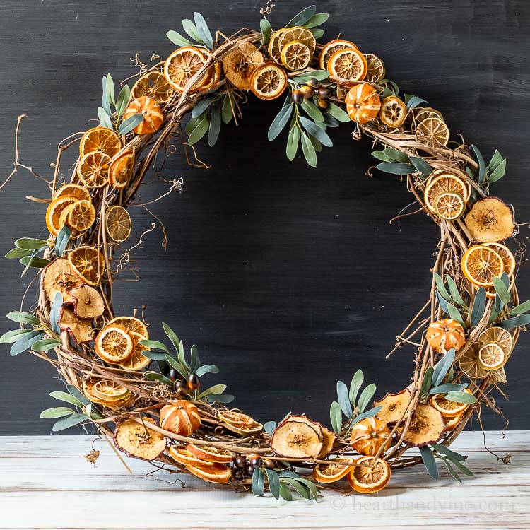 Dried fruit wreath sitting on a table.