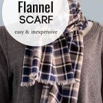 Blue, black, white and gray plaid flannel scarf on a mannequin.