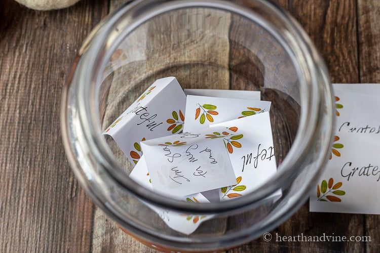 Top down view of grateful cards in a jar.