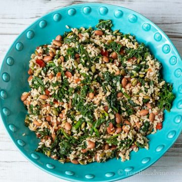 Large blue bowl of greens and grains