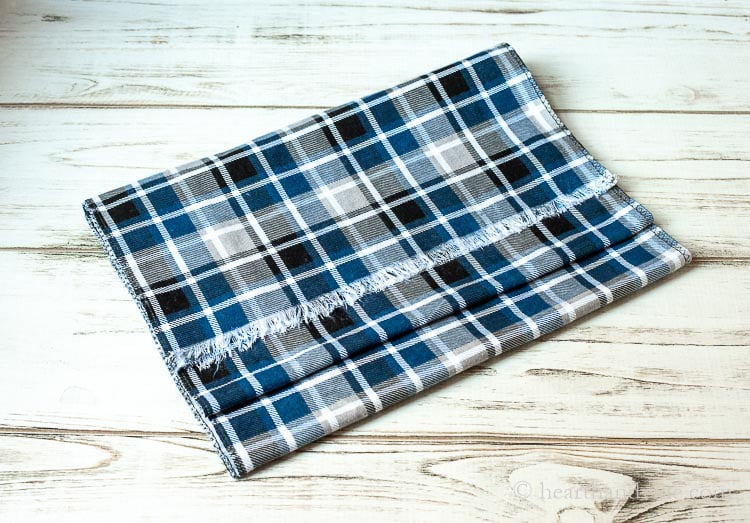 DIY flannel scarf in blue, black, gray and white.