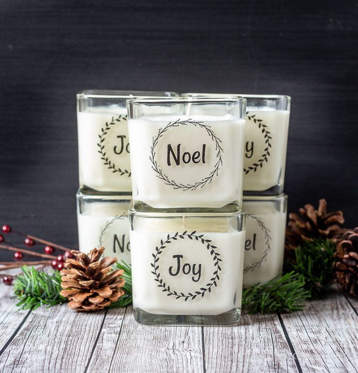Stacks of square Christmas holiday candles with packing tape labels of Noel and Joy.
