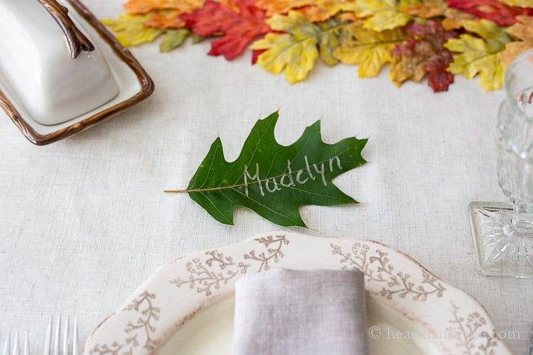 "Fresh green oak leave with gold lettering on top saying ""Madelyn"""