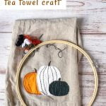 Pumpkin tea towel applique, an embroidery hoop and thread
