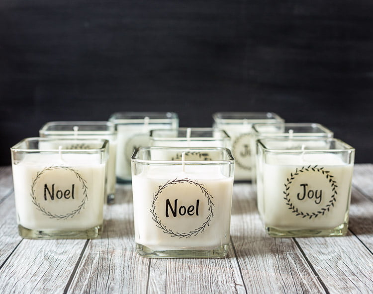 Square glass candleholders with Joy and Noel wreath packing tape labels.
