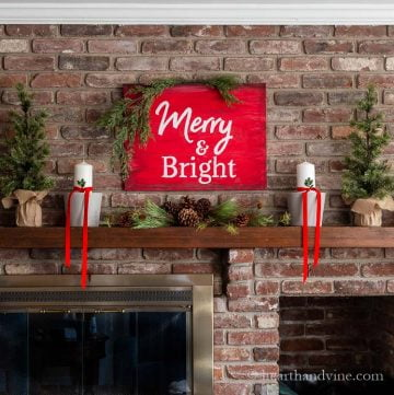 Red and white Christmas mantel with greenery