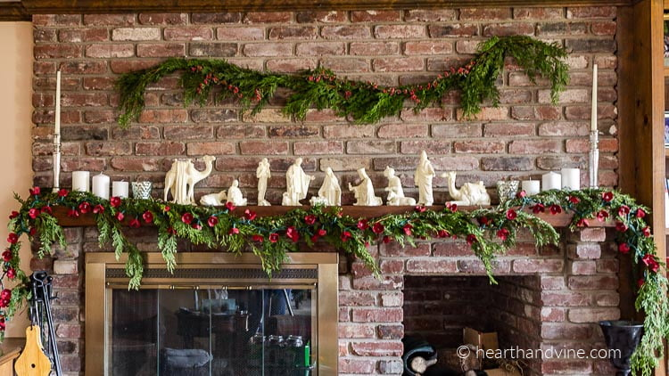 Egg carton flower garland full view of entire mantel decoration.