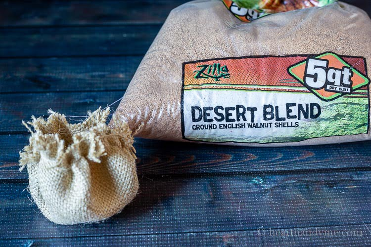 Burlap made into a sack and filled with ground walnut shells.