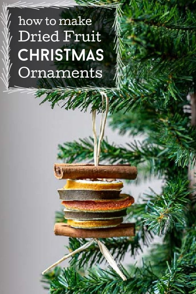 Raffia with cinnamon sticks and slices of dried oranges, lemons and limes threaded on to make a Christmas tree ornament.