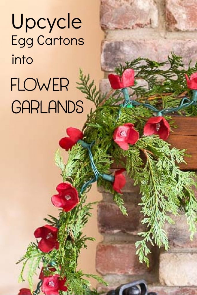 Mini light flower garland with fresh cedar on a mantel.