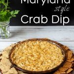 Round pan with Maryland crab dip surrounded with two kinds of crackers.