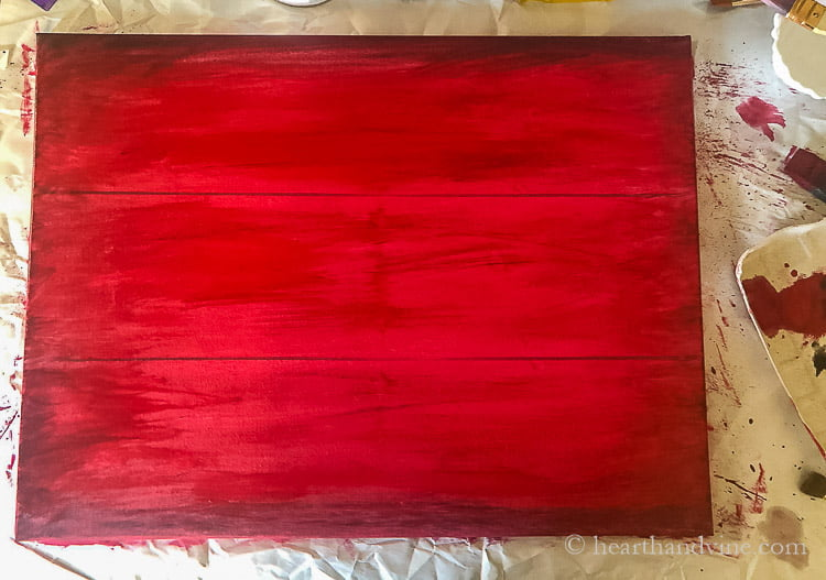 A red canvas with dark edges and two darker lines through 1/3 sections landscape.