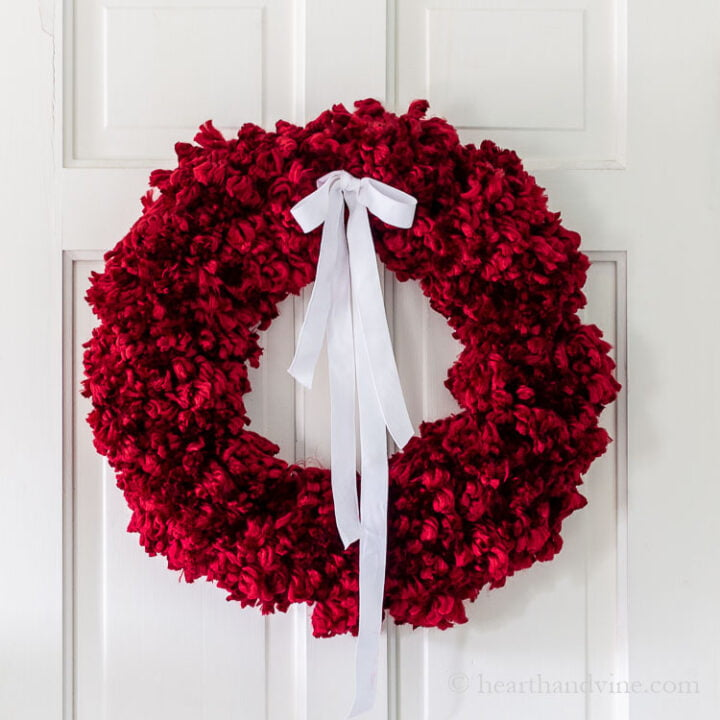 Red pom pom chunky yarn wreath