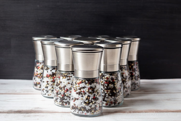 Several salt and pepper grinders lined up like bowling pins.