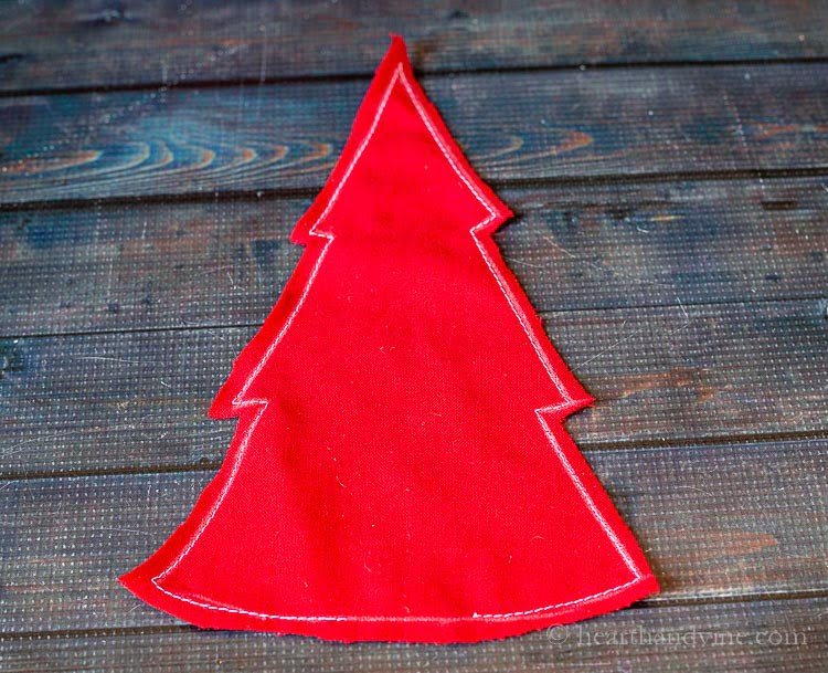 Sewn tree in red fabric.